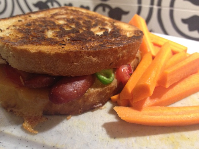 Hot dog toastie with homegrown tomatoes and mild green peppers. Photo by Amy Sowder.