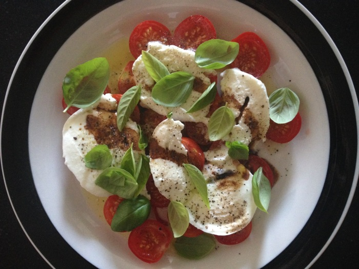 Caprese salad using our homegrown tomatoes and basil. Photo by Amy Sowder.
